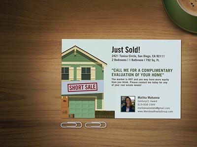 Real estate postcard on table