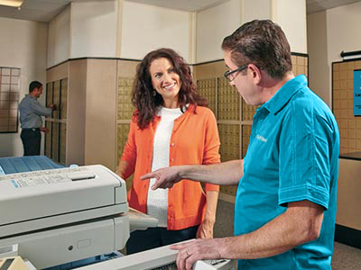 Associate showing customer printer in store