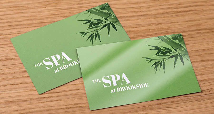 Green spa business cards on a desk